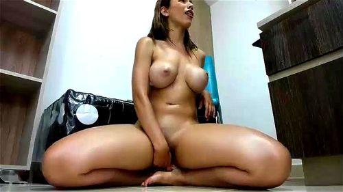 Busty beautiful girl rides her dildo