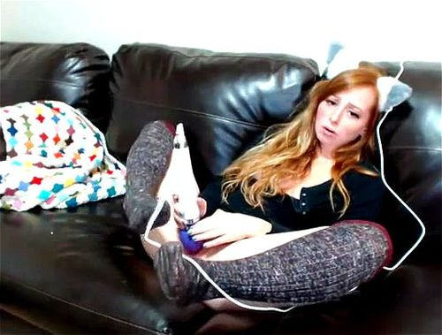 Redheaded hottie May Marmalade masturbating with vibrator on couch
