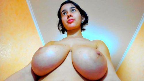 Young brunette Myla Angel flashes her huge boobs on webcam
