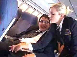 American air hostess strokes a Japanese customer's cock