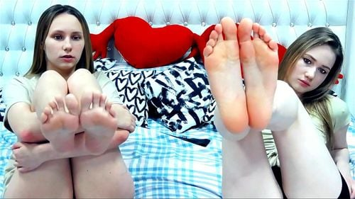 Young camgirls tease on bed 2/2