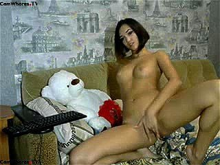 Sexy slim brunette Cheyny flashes pussy & ass on a couch