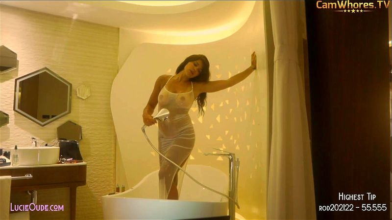 Busty brunette DouxTease hot shower in white dress and topless